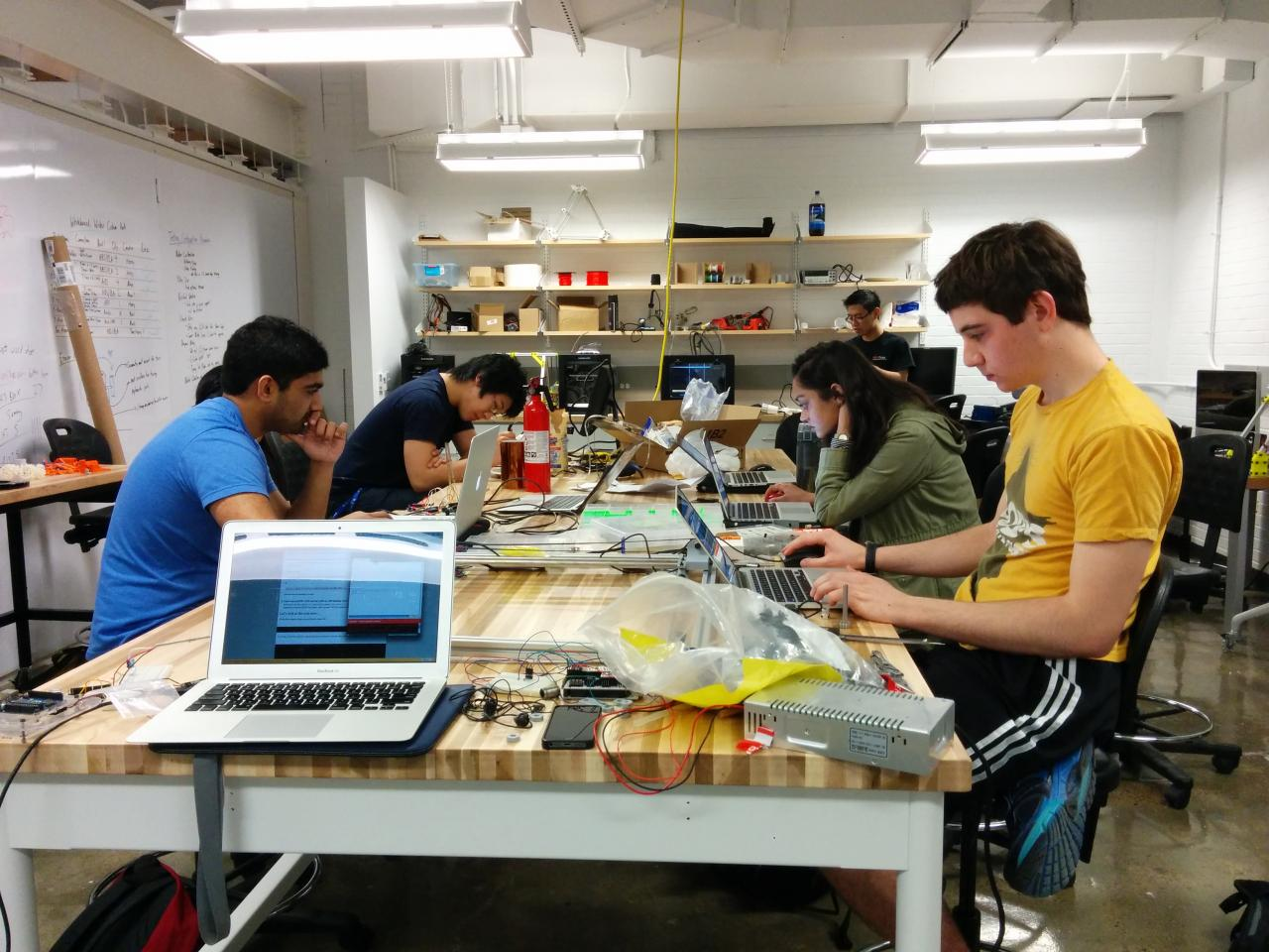 Foundry work spaces feature large adjustable tables and ample whiteboard surfaces ideal for team-based projects