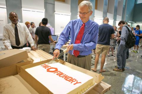 Dr. Truskey cutting the cake to celebrate the opening of The Foundry on Sept. 3, 2015