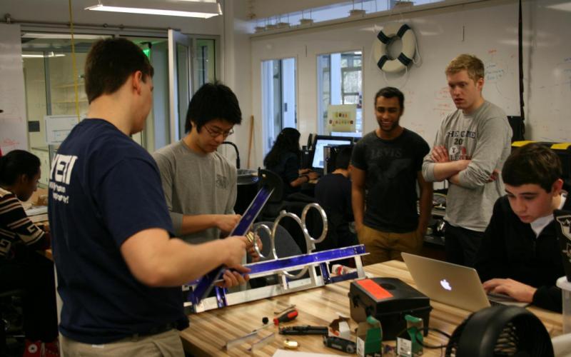 The Duke Robotics club working on their autonomous underwater vehicle